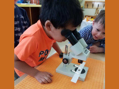 Children using microscope